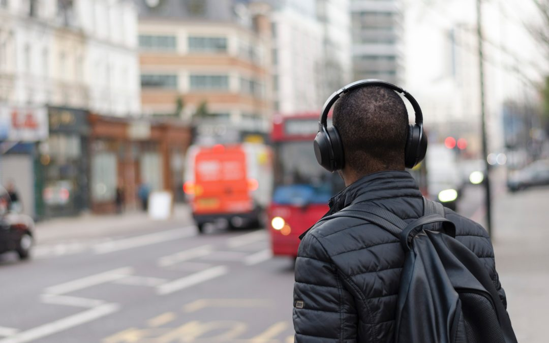 Man with headphones on city street