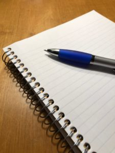 Pad of lined paper and pen
