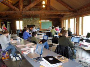 In Print members writing at Camp Winnebago Lodge