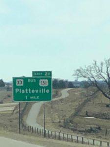 Highway sign - Platteville 1 mile