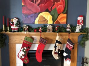 Christmas stockings hanging on the hearth