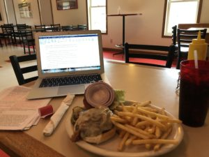 Plate of burger and fries and Kristin's computer at Tofflers Pub & Grill