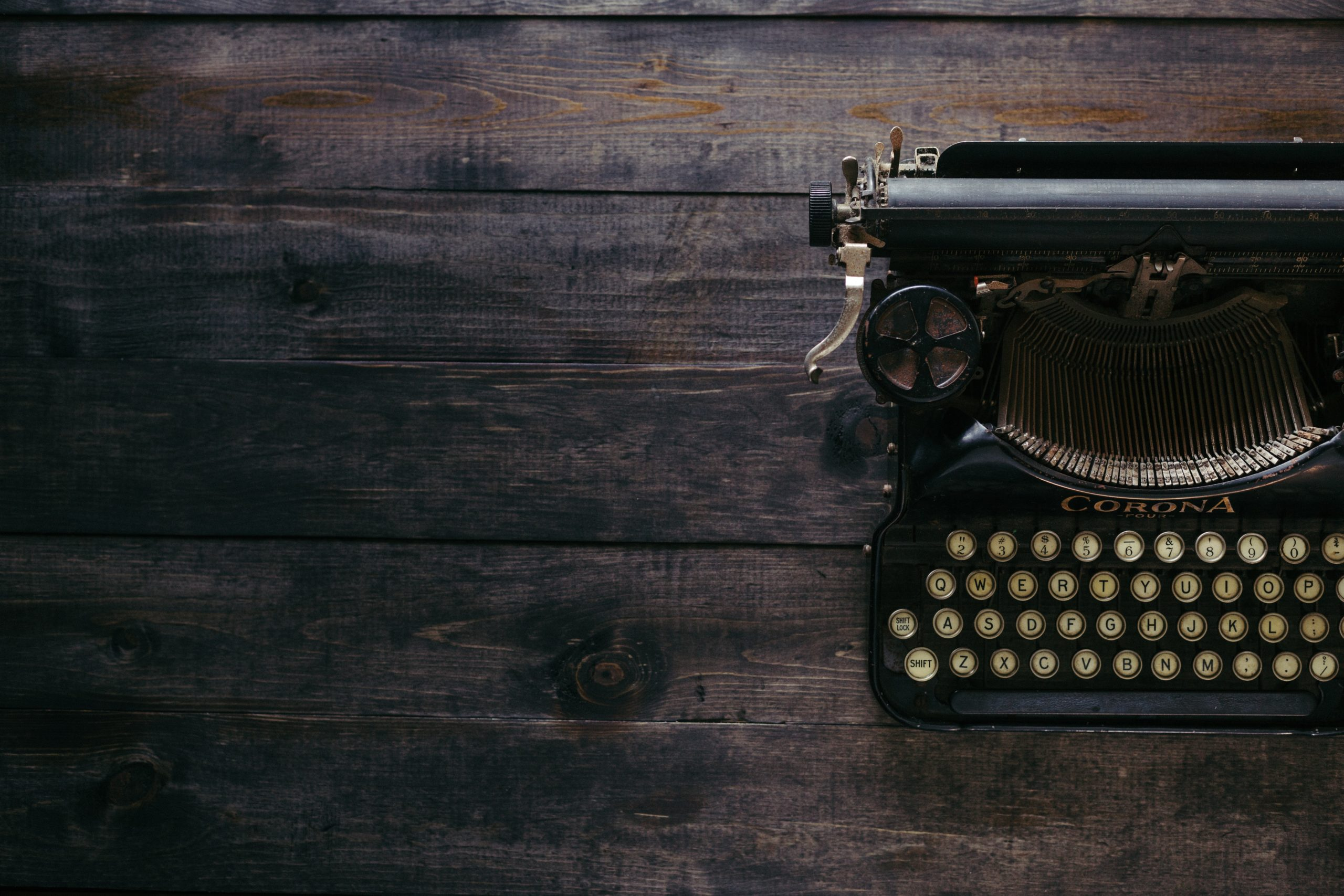 Typewriter on wooden desk