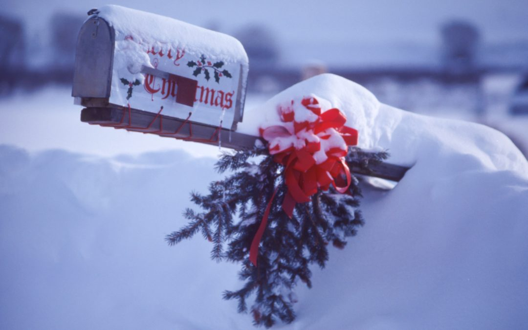 Mailbox with Merry Christmas and wreathe covered in snow