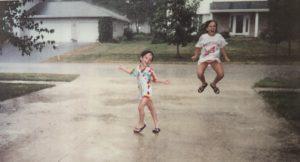 Kristin's daughters singing and splashing in the rain