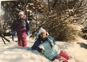 Kristin's daughters climbing on a snow bank