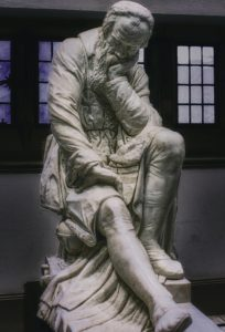 Sculpture of man resting his head on his hand