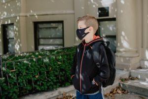 School boy wearing a mask