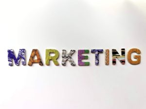 "The word ""marketing"" in colorful letters"