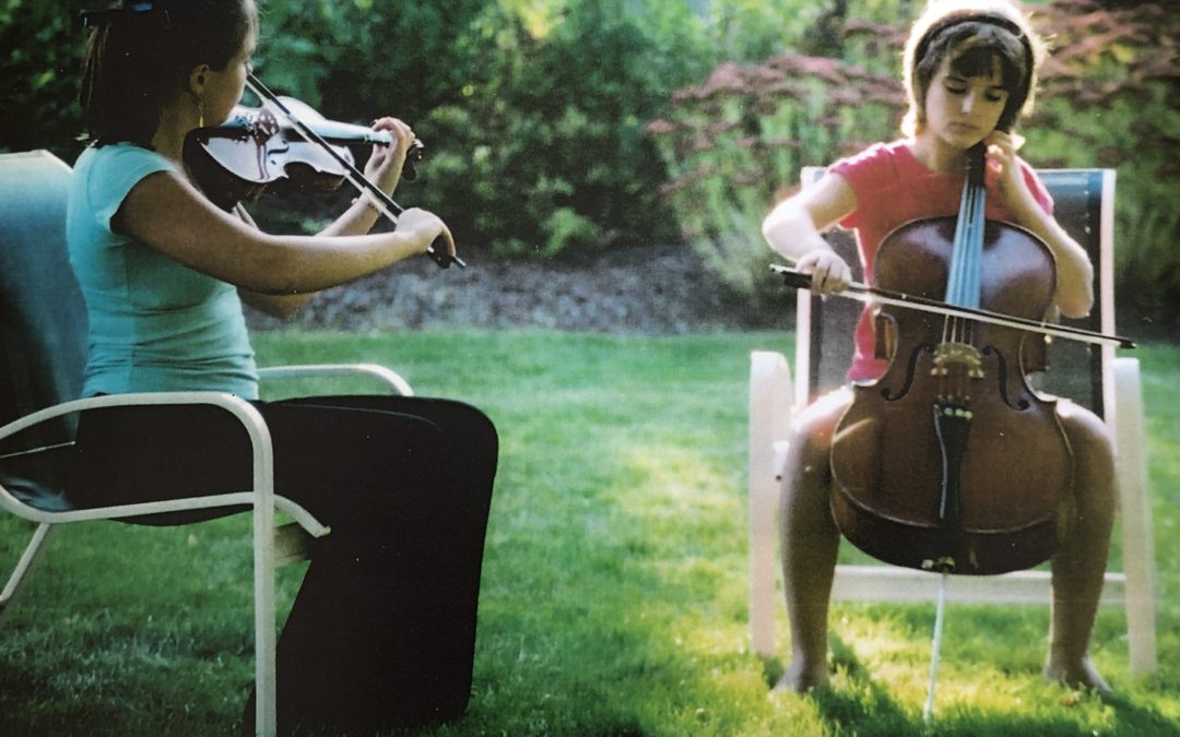 Caitlin and Jessica playing the violin and cello in our backyard