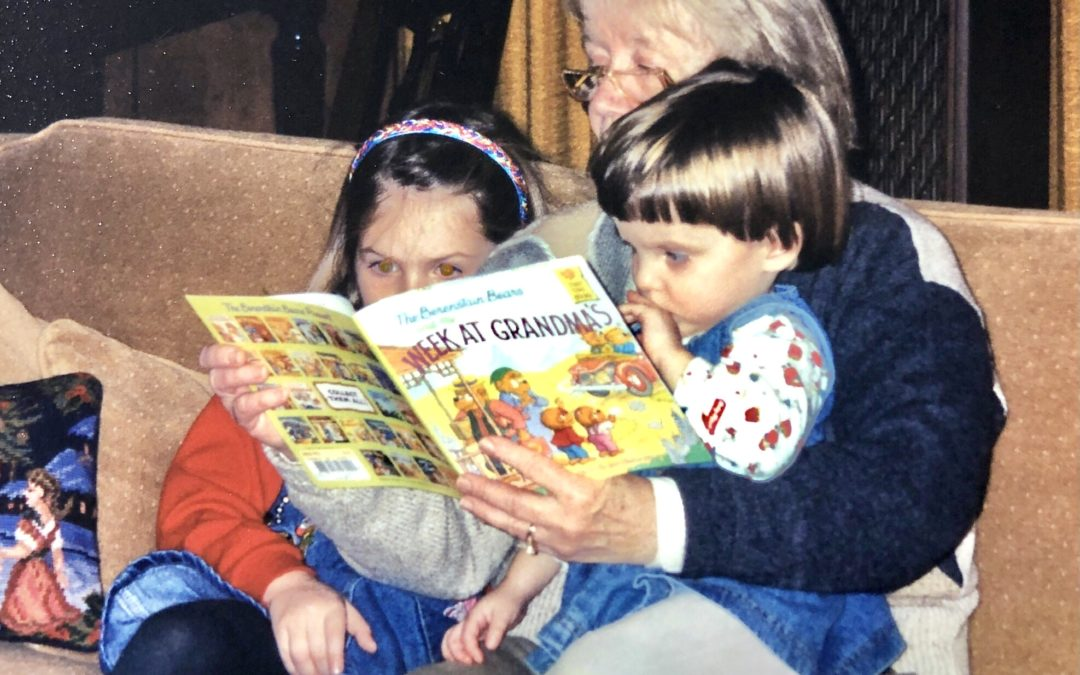 Caitlin, Grandma Jake, and Jessica reading a Berenstain Bear book together