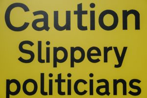 """Sign that says """"Caution Slippery politicians"""""""