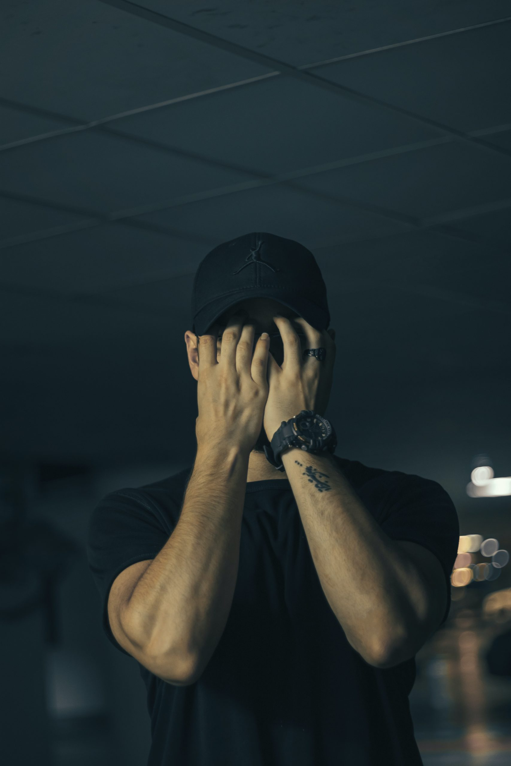 A man holding his face in his hands